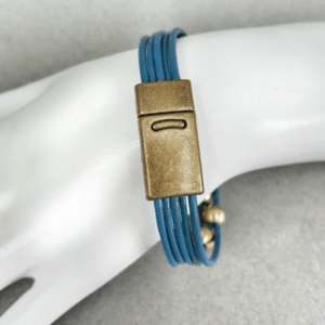 Leather Bracelet Dark Blue with Gold Beads on hand