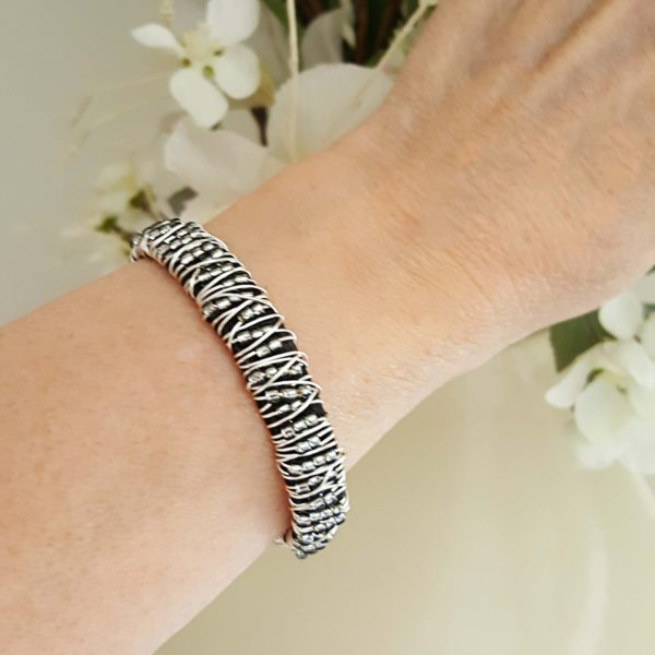 Leather Beaded Bracelet Stacking Shown Close Up On Wrist It Looks Sparkly And