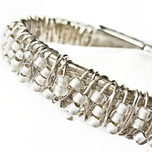 Close up of Champagne Stack Bracelet showing pearl seed beads