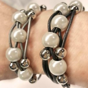 Black Leather Pearl Bracelet and Gray Leather Pearl Bracelet both on wrist