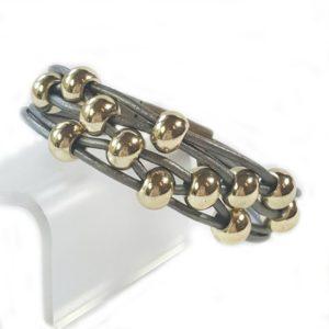 Gray Leather Bracelet Gold Beads close up