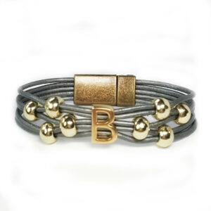 Gray leather bracelet with gold beads and gold initial.