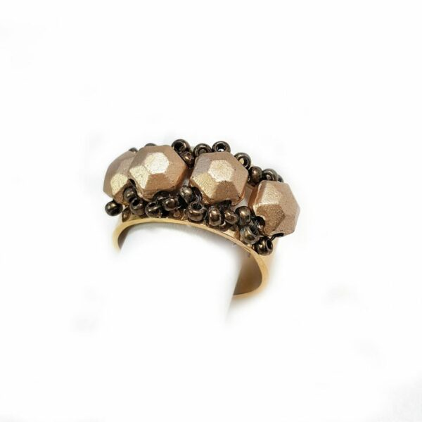 Adjustable size ring gold plated stainless steel.