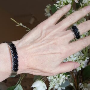 Silver plated stainless steel bracelet and ring set. Beaded with jet black Czech glass beads.
