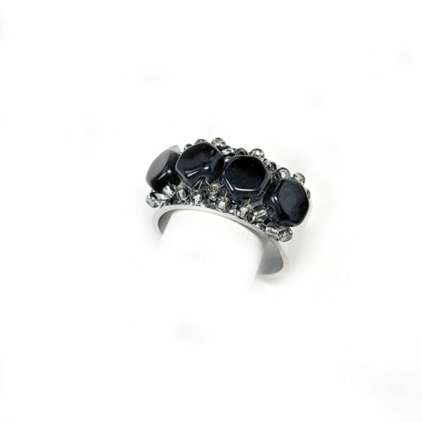 Adjustable size silver ring with black Czech glass beads.