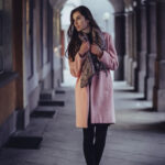 Boho Girl wearing winter camel overcoat.