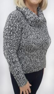 Woman wearing old DIY sweater showing it is too short.