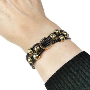 Initial C leather bracelet close up on wrist.