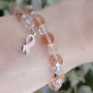 Breast Cancer Bracelet made with Austrian crystals on memory wire accented with silver trimmed ribbon charm.